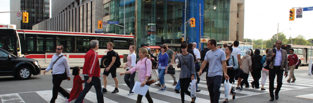 Photo of pedestrians crossing the intersection of Yonge and Eglinton