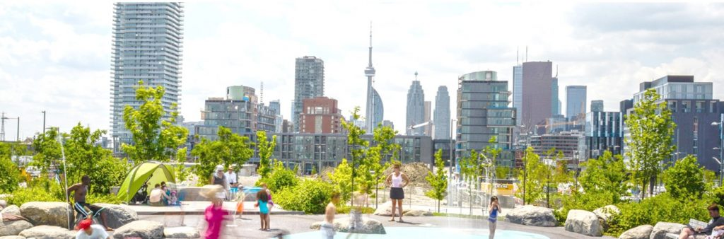 View of Corktown Common splash pad looking east to downtown Toronto