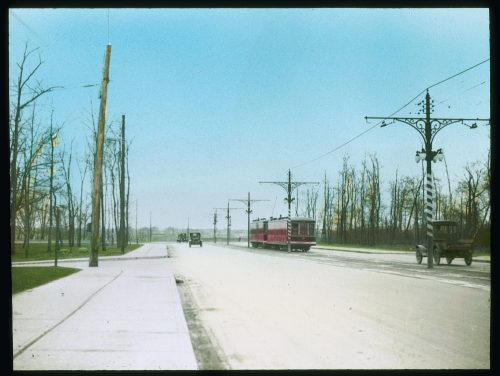 Streetcar on roadbed of viaduct.