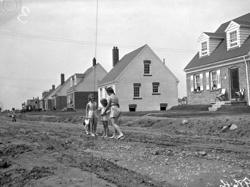 Small wartime houses and unpaved road