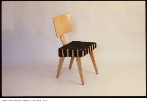 Blonde wood chair with black webbing seat.