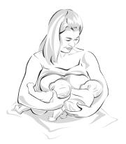 woman holding 2 babies one parallel at the other