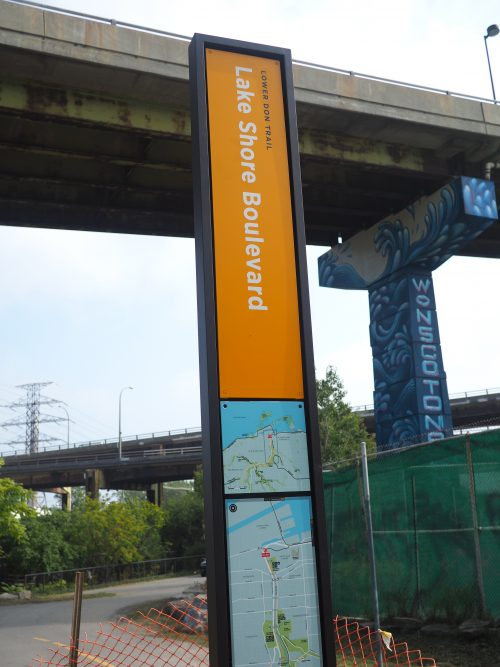 Photograph of orange signage on the Lower Don Trail