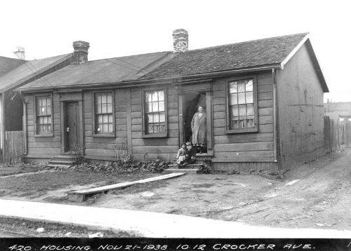 Small one-storey wooden row houses in poor condition