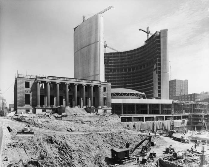 City Hall under construction and the Registry Building being demolished
