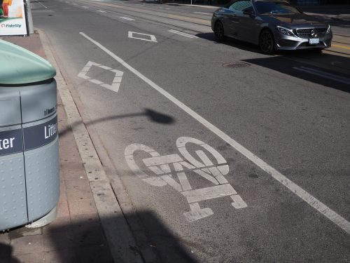 Painted bike lane on Bay St north of Dundas St W