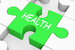 An image with a green puzzle piece labeled with the word Health.