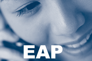 A cropped photo of the City of Toronto's EAP brochure, which has a woman smiling and holding a telephone receiver to her ear