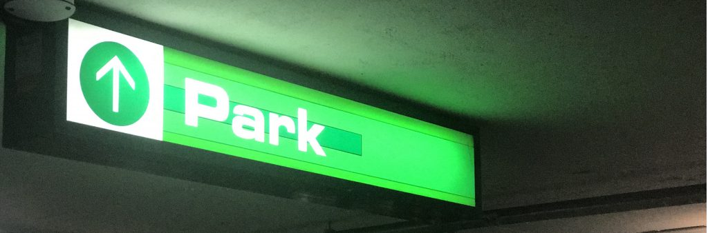 Image of parking sign in garage parking lot