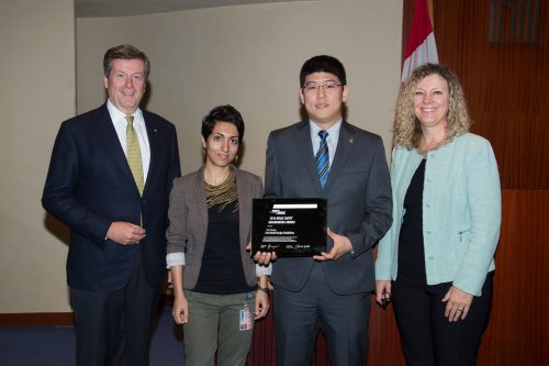 Mayor John Tory and Public Works and Infrastructure Committee Chair, Jaye Robinson present Pedestrian Projects staff members Sheyda Saneinejad and Justin Bak with the 2016 TAC Road Safety Engineering Award at the October 2016 meeting of Toronto City Council