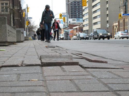 Uneven sidewalk pavers on Bloor Street. Photo credit: Toronto Star