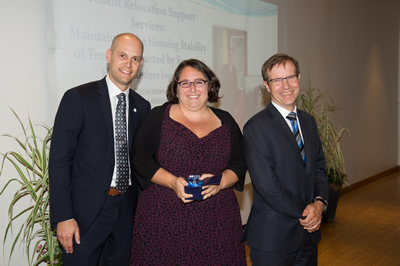 Image of award winners. Left to right: Jeremy Kloet (City Planning), Alexandra Vamos (SSHA), Peter Wallace (CMO)