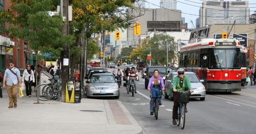 Image of College street showing motorists, transit users, cyclists and pedestrians, and supports vibrant commercial zones