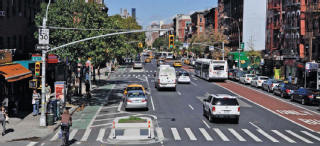 Image of street with bike lanes, bus lanes, parking and vehicles