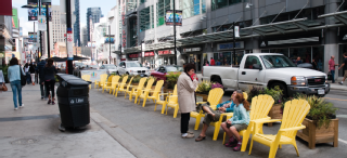 Image of Yonge Street with seating along the curb lane