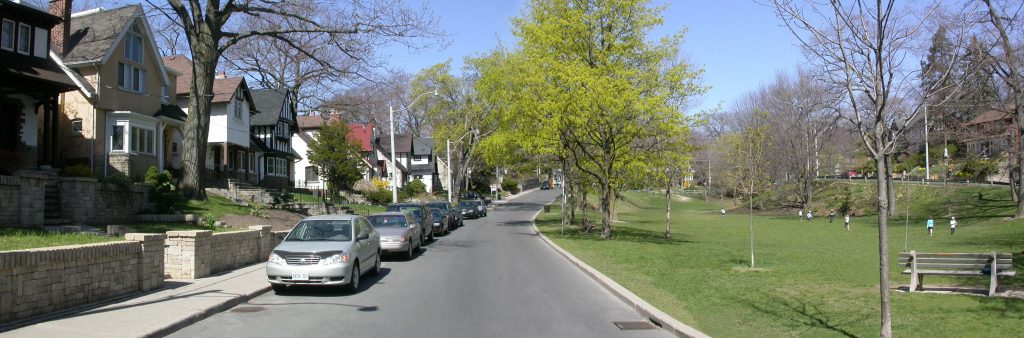 Image of cars parked on a residential street
