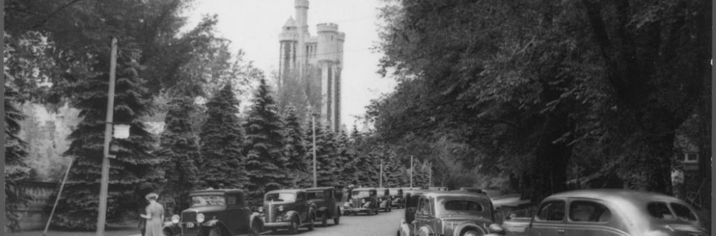 This is an archival photograph from 1939 that shows the Casa Loma Stables and tower seen from Walmer Road