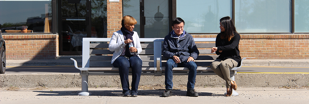 Image of three people sitting on a bench
