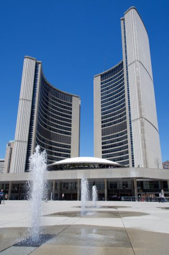 View of Toronto City Hall with the disappearing water feature in the foreground