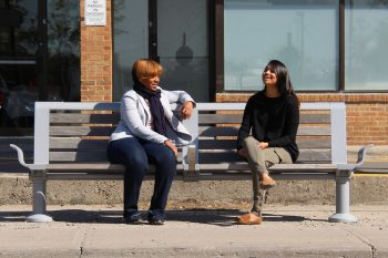 Two girls sitting on a bench