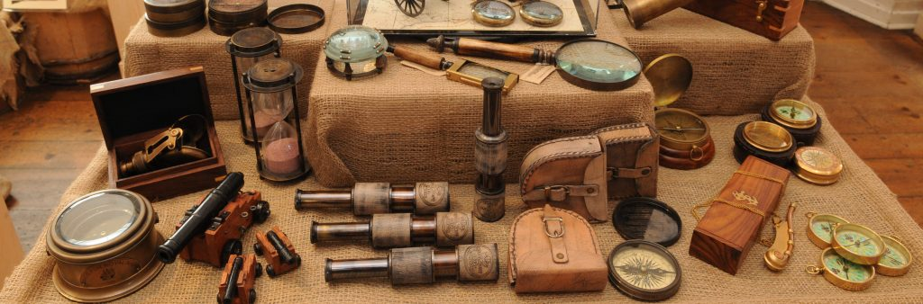 Table featuring historic reproduction items for sale at Fort York