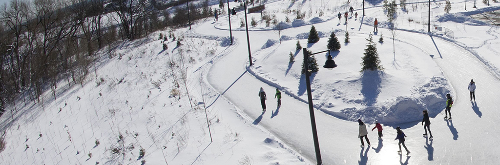 An aerial view of people skating on an outdoor skate trail