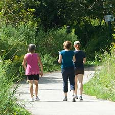 Image of 3 women walking through Humber River