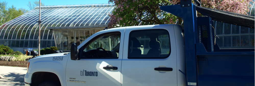 Photo of City Truck in front of greenhouse