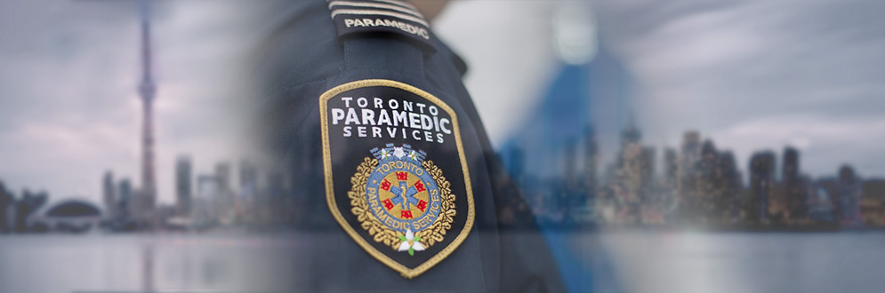 Close up of a Toronto Paramedic Services badge on a uniform