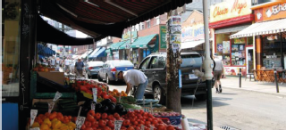 Image of fruit stall on a small street