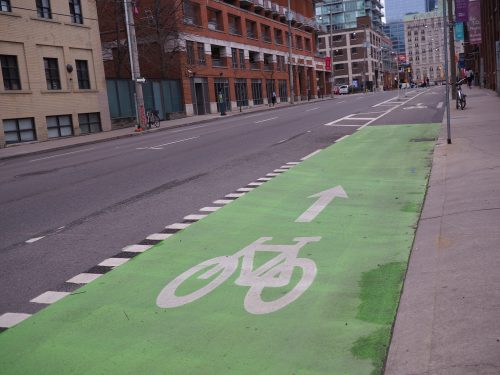 Green paint along the Richmond St cycle track increasing the visibility of the cycle track