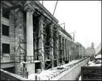 Scaffolding can be seen around some of the pillars that make up the main entrance during the construction of Union Station.