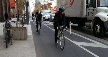Adelaide St looking- est with 3 bikes in cycle track
