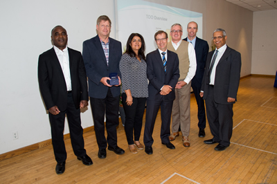 Image of award winners. Left to right: Gary Thompson, Henry Polvi, Rose Hosseinzadeh, Peter Wallace, Mark Clancy, Mike Brannon, William Fernandes