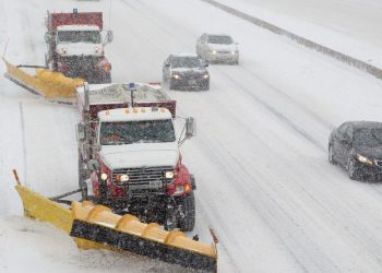 Image of City snow plows on the highway