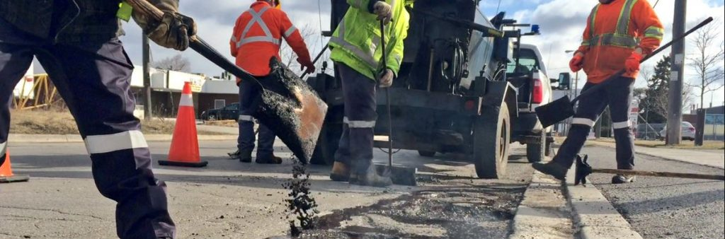 Image of City crews filling a pothole