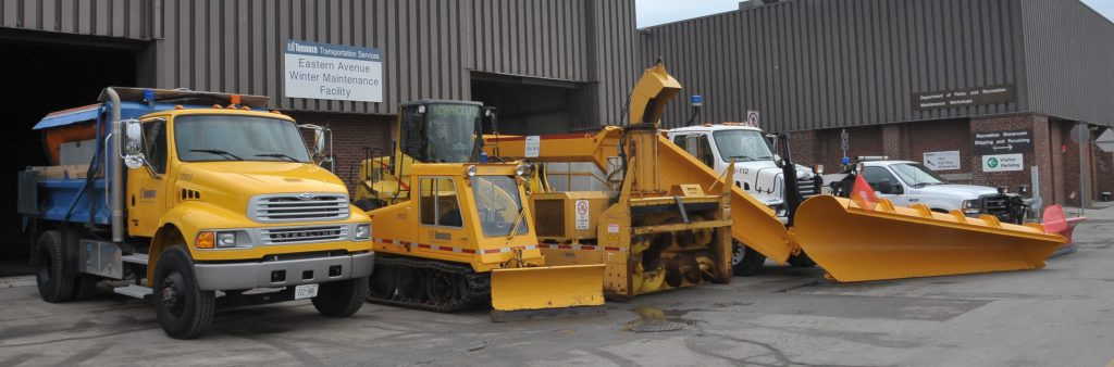 Image of the Citys winter maintenance fleet of trucks and plows