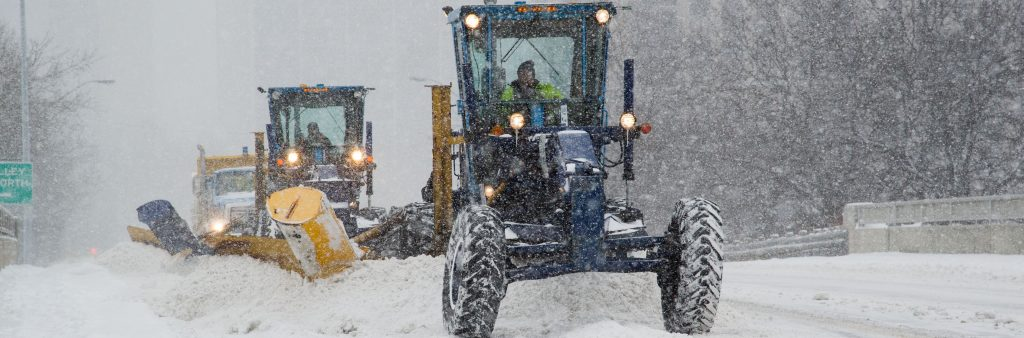 Image of sidewalk plows clearing the street