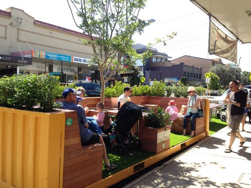 Clovelly Road, Glebe, Australia: Parklet - converted yellow shipping container with benches, tree and shrubs.