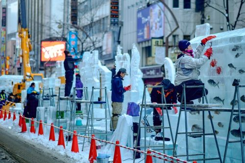 Ice Sculptures, Sapporo, Japan: 3 people sculpting ice at street festival.