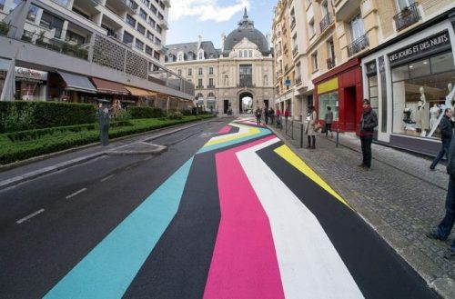 Street Mural, Rennes, France: Blue, black, pink, white and yellow geometric mural painted on the the road.