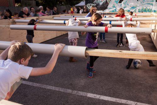 """Human Foosball, 7 kids playing """"human"""" foosball."""