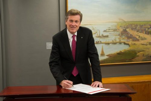 Mayor John Tory signs the Integrating Cities Charter