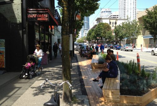 Robson Street, Vancouver: Parklet - additional pedestrian zone, wooden bench with plants.