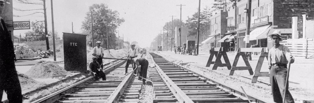 This is a photograph of the installation of streetcar tracks on Bloor Street West west from Runnymede Street in 1921.