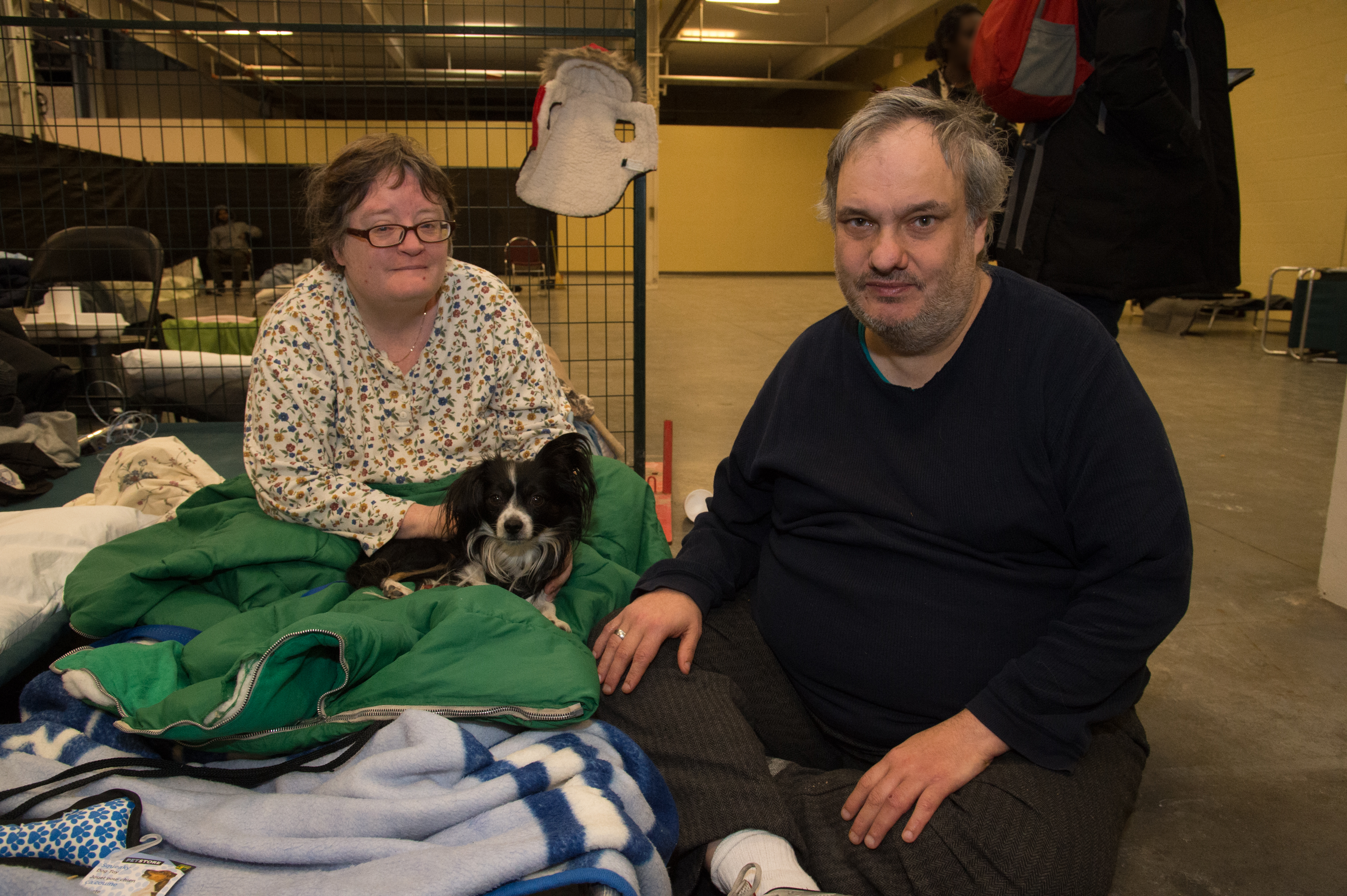 Dawn Frazer and Rob Bizior at the Better Living Centre sitting on the floor with their dog