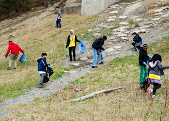 Residents pick up trash during Clean Toronto Together.