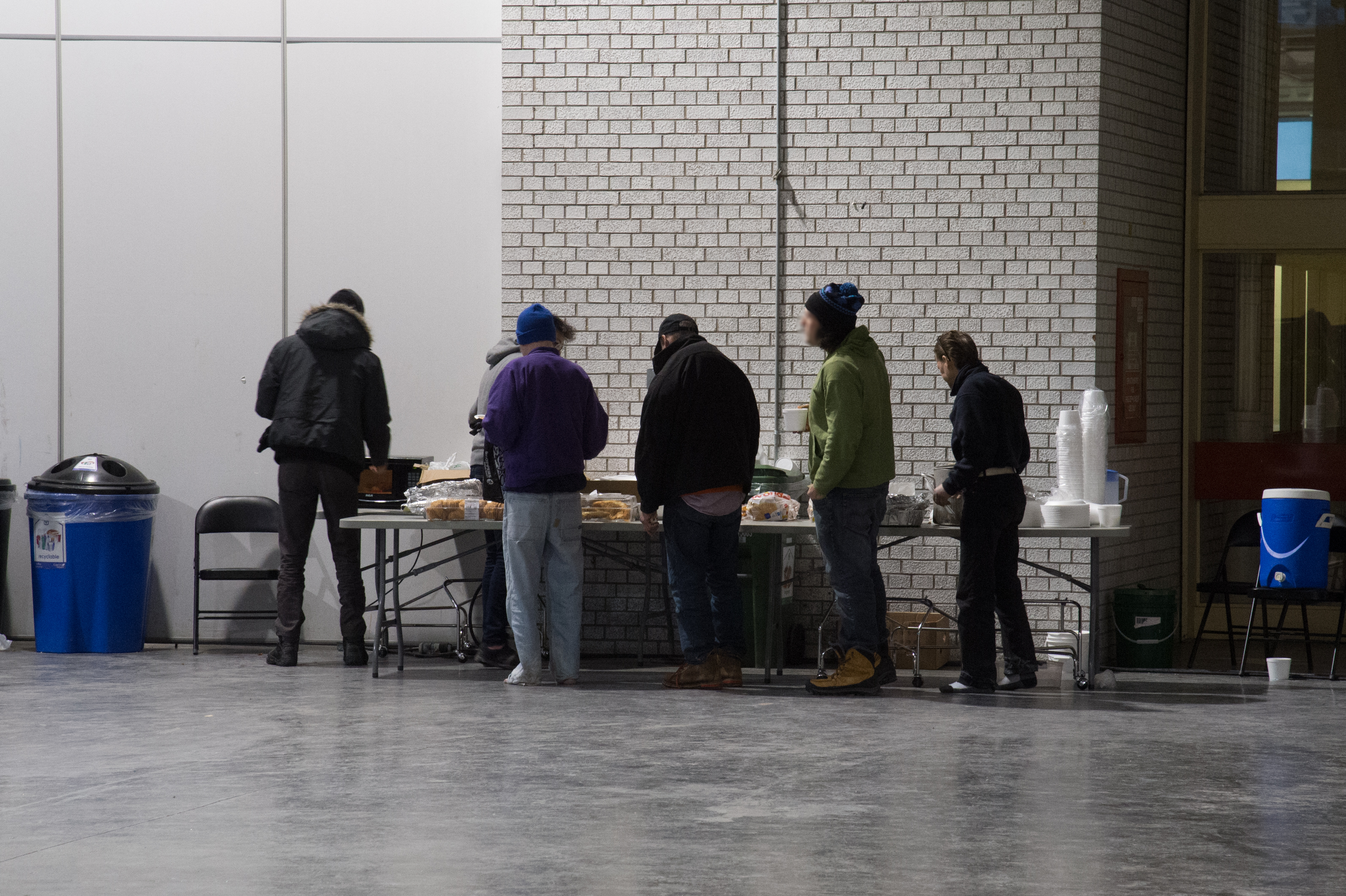 Photo of clients in line for food at the temporary shelter located in the Better Living Centre at Exhibition Place