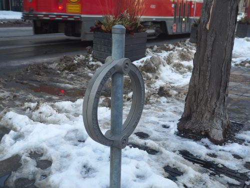 A 2006 redesign of the post and ring added an additional ring to further prevent bicycle theft