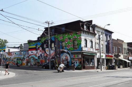 This is a photograph of the north east corner of Queen Street West and Claremont Street